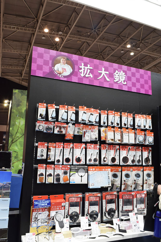 An evergreen in Kenko Tokina booth is the corner dedicated to magnifying glasses and loupes.